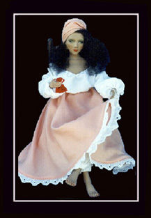 Click here to view close-up the African American Doll, The Marie Laveau Doll holding gris gris bag.